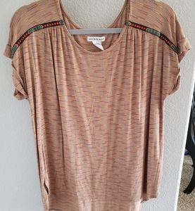 Soft tan t shirt with embroidery detail